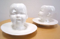Baby head vase by mudpuppy